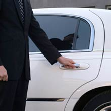 limo driver holding the door handle